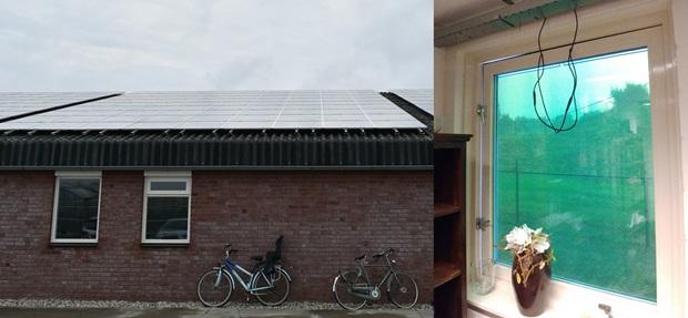 농장지붕의 태양광패널과 창문에 설치된 태양전지판.